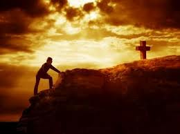 climbing a a hill to the cross
